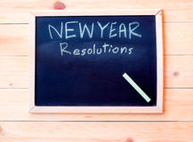 New Year. Resolutions written on blackboard with color chalk Royalty Free Stock Photography