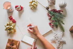 New year resolutions written with a hand on notebook with new years deco Stock Photography