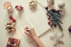New year resolutions written with a hand on notebook with new years deco retro style Royalty Free Stock Images