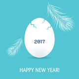 New year of rooster card with egg and feathers. New year card with egg and feathers. The year 2017 of rooster Stock Photo
