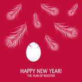 New year of rooster card with egg and feathers. New year card with egg and feathers. The year 2017 of rooster Royalty Free Stock Photography
