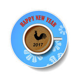 With the new year rooster. The image of the bird on a cup of coffee. royalty free stock photo