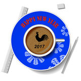 With the new year rooster. The image of the bird on a cup of coffee. stock photo
