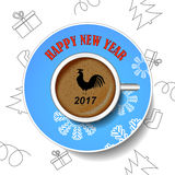 With the new year rooster. The image of the bird on a cup of coffee. royalty free stock photography