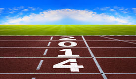 New Year 2014 on running track concept with blue sky. Royalty Free Stock Photo