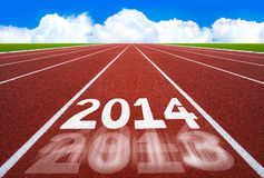 New Year 2014 on running track concept with blue sky. Royalty Free Stock Photos