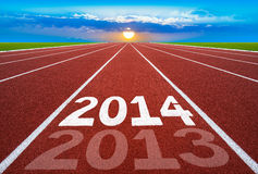 New Year 2014 on running track concept with sun & blue sky.