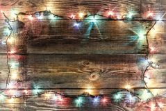 New Year`s background. Christmas background Christmas garland. New Year`s frame. Christmas background. Christmas garland with colored lights and lamps on a Royalty Free Stock Photography