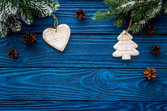 New year`s background. Christmas toys, spruce branches, pine cone on blue wooden background top view copyspace Stock Photography