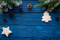 New Year`s Background. Christmas Toys, Spruce Branches, Pine Cone On Blue Wooden Background Top View Copyspace