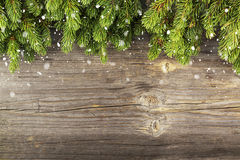 New Year`s background: fluffy green fir branches on a On atmospheric wooden background under the inscription with a free Royalty Free Stock Photography