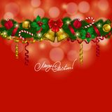 New Year's background - a garland of fir branches. Bow, bells, balls, baubles, gifts, lollipops for greeting card, invitation. Christmas festive bokeh Stock Photography