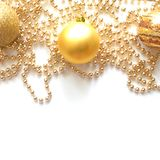 New Year`s background with gold toys and a garland Royalty Free Stock Photos