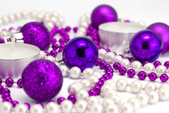 New Year's background from toys and a beads. On a white background Stock Photo