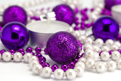 New Year's background from toys and a beads. On a white background Royalty Free Stock Photo