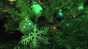 New Year`s ball against the background of the decorated garland of a Christmas tree.  stock footage
