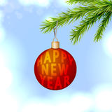 New Year's ball on the fir branch. Snowy Christmas Background. New Year card Royalty Free Stock Images