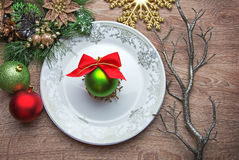 New Year's ball on the plate with Xmas decoration Royalty Free Stock Image