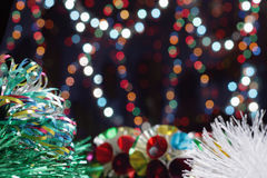 New Year's balls. On a background of color garlands Stock Images