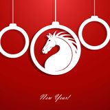 New Year's balls with a silhouette of a horse. Stock Photos