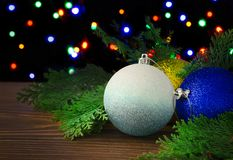 New Year`s balls, toys, bells, Christmas tree. On the background of a bokeh of garlands Stock Photos
