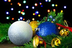 New Year`s balls, toys, bells, Christmas tree. On the background of a bokeh of garlands Stock Images