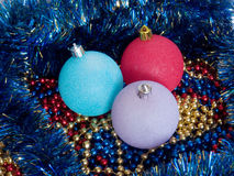 New Year's beads. Three multi-coloured spheres lie on a New Year's beads Royalty Free Stock Photo
