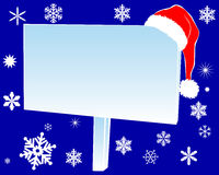 New Year's billboard. With red cap with snowflakes on blue background Stock Image