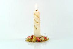 New Year's candle. The New Year's candle burns on a white background Stock Image