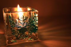 New Year's candle. Candlestick with an ornament in the form of a snowflake royalty free stock images