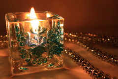New Year's candle. Candlestick with an ornament in the form of a snowflake stock image