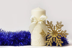New Year's candle and snowflake stock image