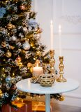 New Year`s candles and a Christmas tree in the lights. Stock Image