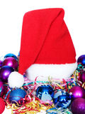 New Year's cap. Among multi-coloured Christmas ornaments stock image