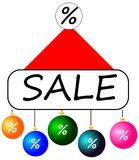 New Year`s cap with the sale and Christmas toys Royalty Free Stock Images
