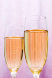 New Year's card. Glasses of fizz on the table Royalty Free Stock Image