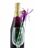 New Year's Celebration. Bottle of champagne with a glass and party favor, isolated on white Stock Images