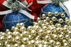 New Year's celebratory ornaments and golden beads. New Year's celebratory ornaments and celebratory beads of golden color Stock Image