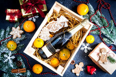 New Year`s champagne and tangerines in box top view Stock Photos
