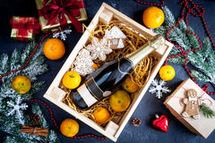 New Year`s champagne and tangerines in box top view Royalty Free Stock Images