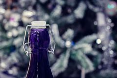 New Year`s champagne. Throat with a blue bottle stopper stock images