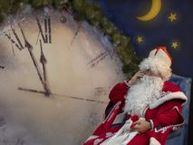 Father Frost calls by telephone near huge hours. royalty free stock photography