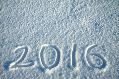 New Year's and Christmas background from snow.text on snow 2016 Royalty Free Stock Photos