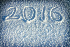 New Year's and Christmas background from snow.text on snow 2016 Stock Images