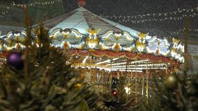 New Year`s Christmas carousel on the square in the city. stock video footage