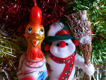 New Year`s and Christmas. The cheerful snowman and symbol of 2017 - the Red Fiery Rooster. The interior of the New Year. Royalty Free Stock Image