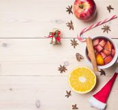 New Year`s and Christmas decoration with ingredients for preparation mulled wine, cinnamon and cloves, lined Border on a whit royalty free stock photo