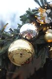 New Year`s, Christmas decorations, toys. New Year`s, Christmas decorations, toys, a huge `golden` ball, electric garlands on a branch of a Christmas tree Stock Images