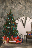 New Year's and Christmas interior with hours Royalty Free Stock Photo
