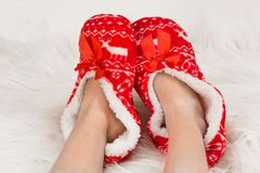 New Year`s, Christmas slippers for adults are dressed for the child. On white soft fur. Funny, funny, humorous, cozy,. New Year`s, Christmas slippers for adults Royalty Free Stock Image